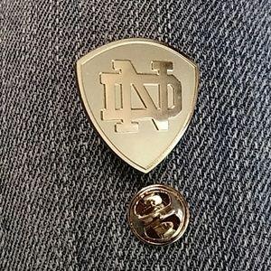 Solve Notre Dame lapel pin